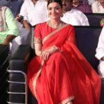 Actress Kajol wearing Red Organza Saree