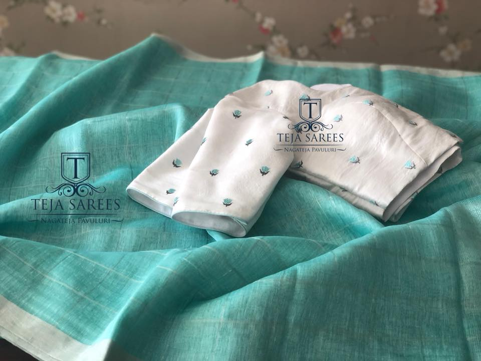silver checks blue linen saree with designer blouse from teja sarees