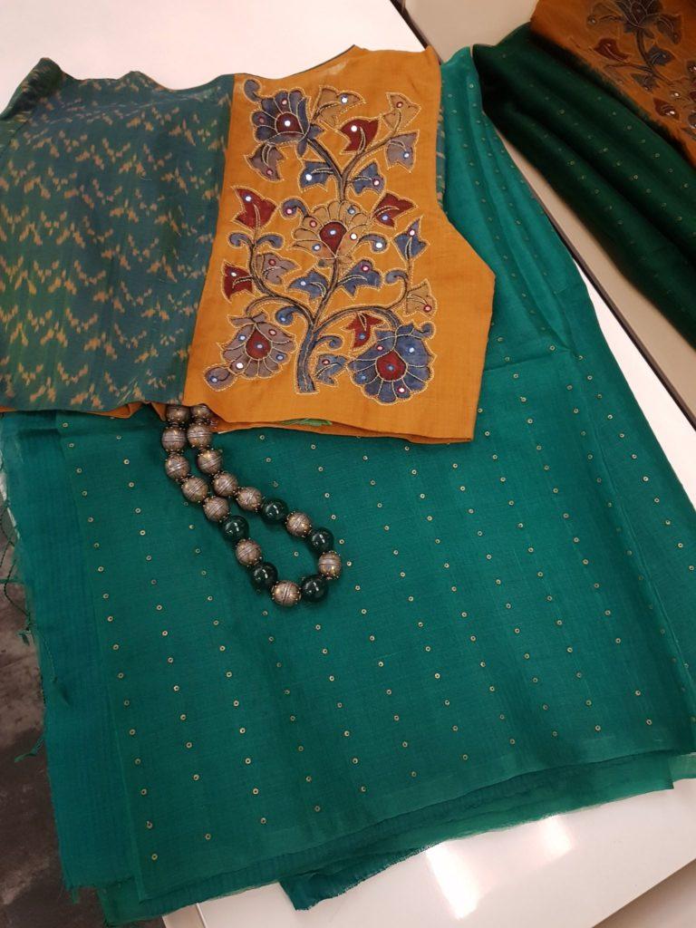 dark green woven sequins organza saree from aavaranaa