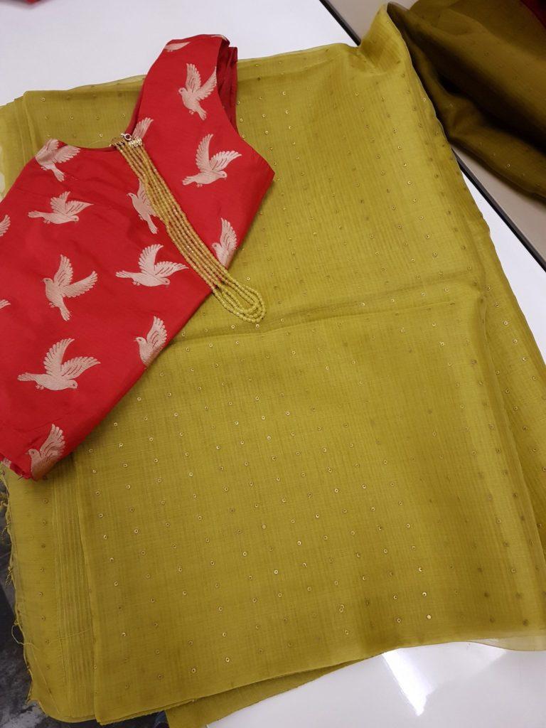 mehandi green woven sequins organza saree from aavaranaa