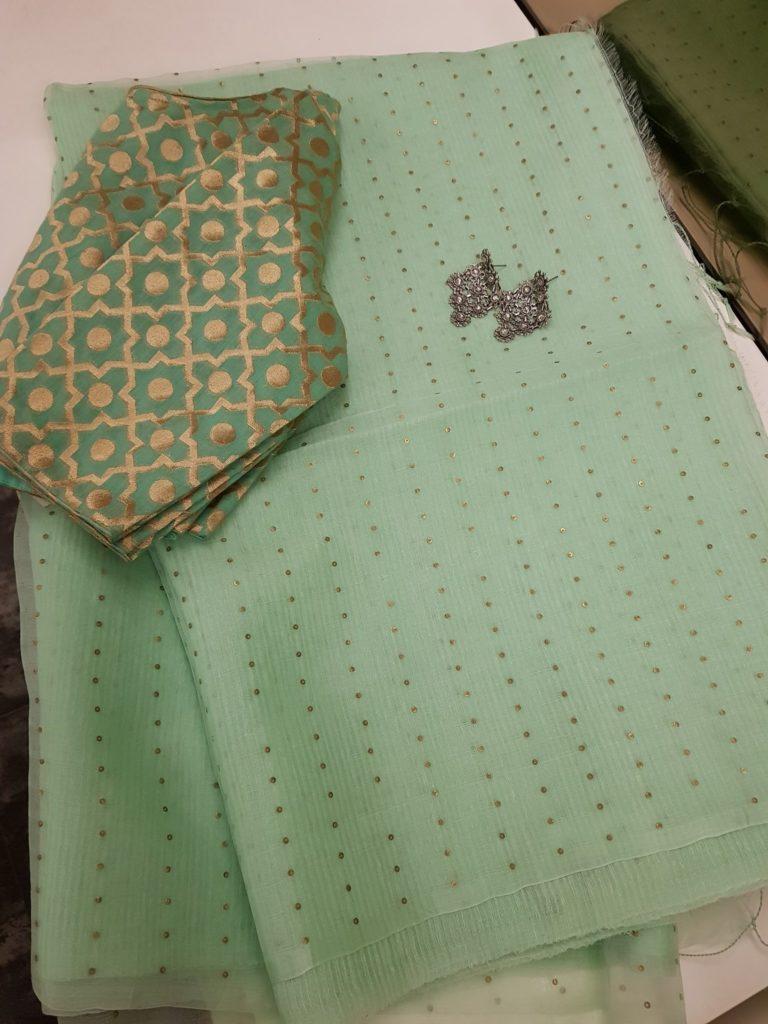 pista green woven sequins organza saree from aavaranaa
