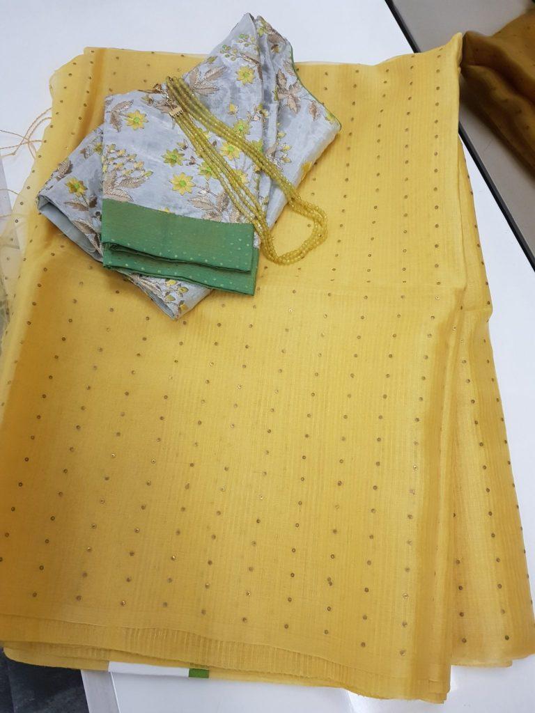 sunshine yellow woven sequins organza saree from aavaranaa
